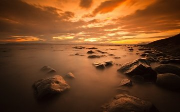the sky, clouds, stones, sunset, sea, horizon